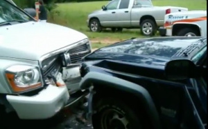 Front view of a black and white car dashed against the each other