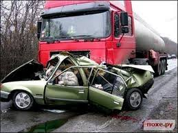 truck collided with green colour car